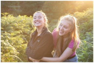 Two teenage sisters laughing in the evening light