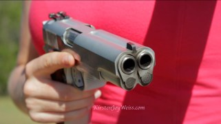 holding double barrel close up gun words