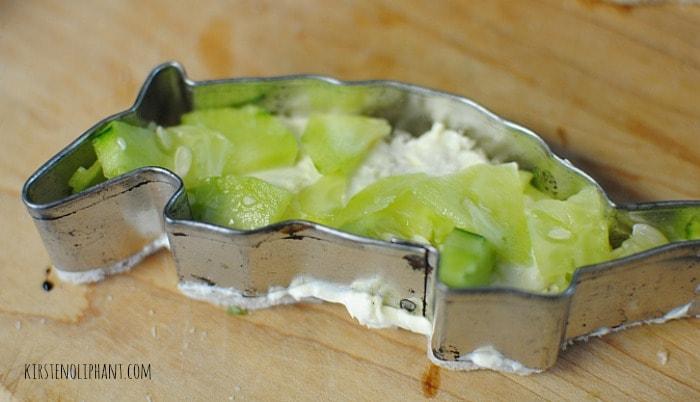 Filling a cucumber sandwich.