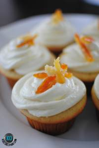 Champagne cupcakes with orange ginger frosting and & candied ginger and orange peels