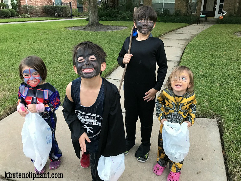 I promise my boys were trying to be ghouls, hence the black faces. They had hoods (not pictured) to make them scary and invisible after dark.