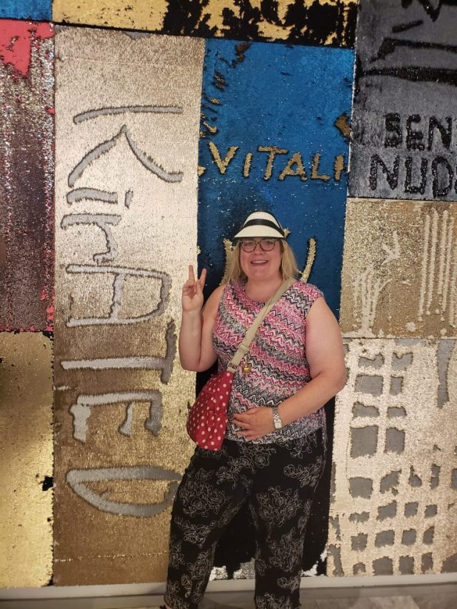 "Kirsten Voege of KIRated Communications at the sequin wall, aka ""I Was Here,"" by Lara Schnitger at Hudson Yards in NYC"