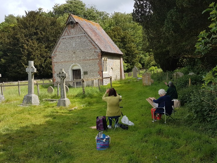 painting group in church yard