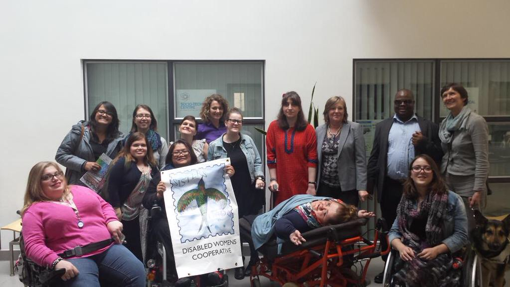 photo of participants, some in wheelchairs, all women except for one black man
