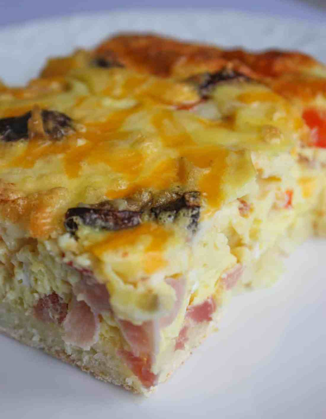 This Breakfast Casserole is a great alternative to the standard bacon and egg brunch or breakfast.  The egg layer is loaded with vegetables and meat before it is poured over a gluten free crust.