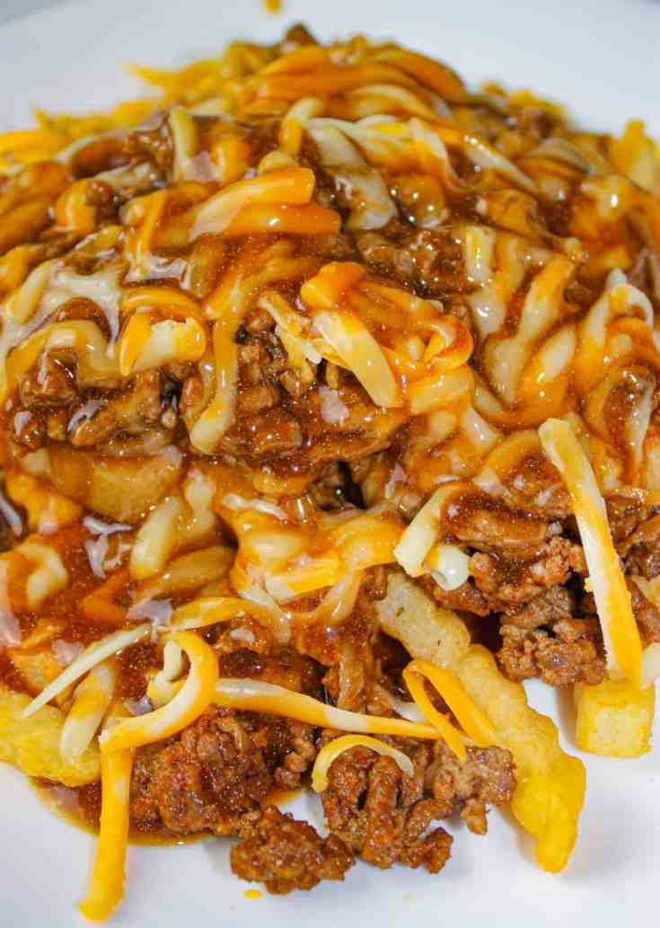 Tex Mex Poutine is a quick and easy recipe that would be great for a Super Bowl Party. But don't just save it for a special occasion because it deserves to be served any day of the year!