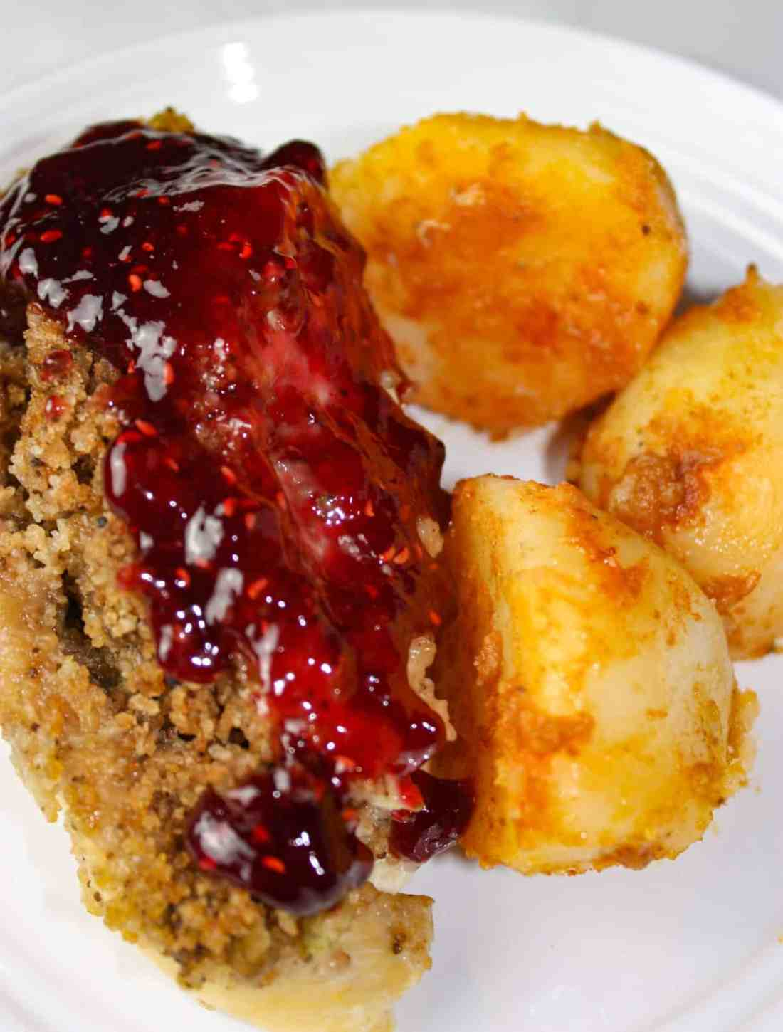 Instant Pot Stuffed Chicken Breasts and Seasoned Potatoes is a gourmet style meal that is very appealing when plated.  Each chicken breast is loaded with gluten free stuffing and then smothered in a tangy raspberry sauce.