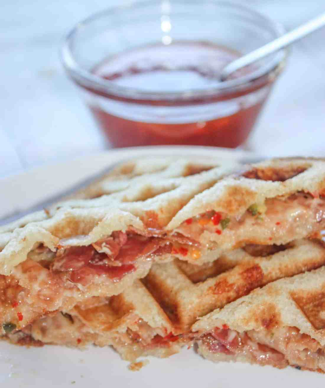 Peppery mozzarella cheese, topped with bacon slices, layered between slices of gluten free bread pressed in the waffle iron to create an appetizing delight.  Spicy Waffled Grilled Cheese with Bacon wakes up the taste buds with a burst of heat.