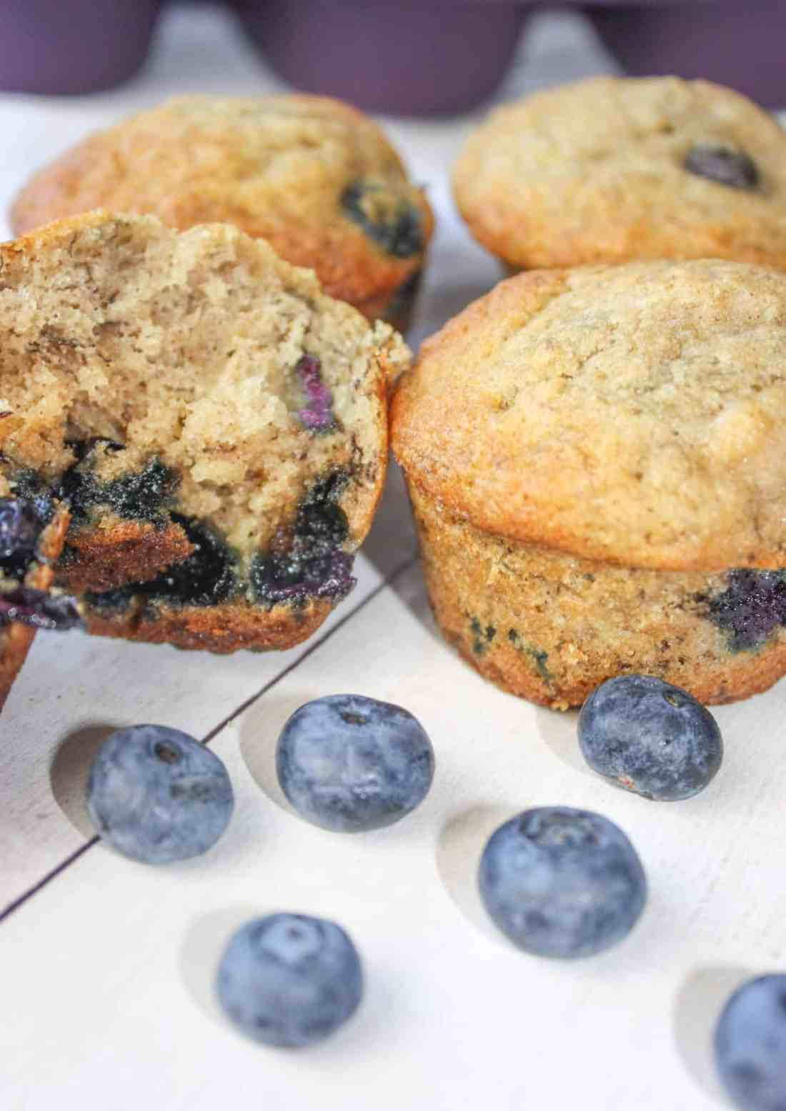 Blueberry Banana Muffins are a tasty seasonal twist on traditional banana muffins.  This moist and delicious gluten free snack is loaded with fresh blueberries.