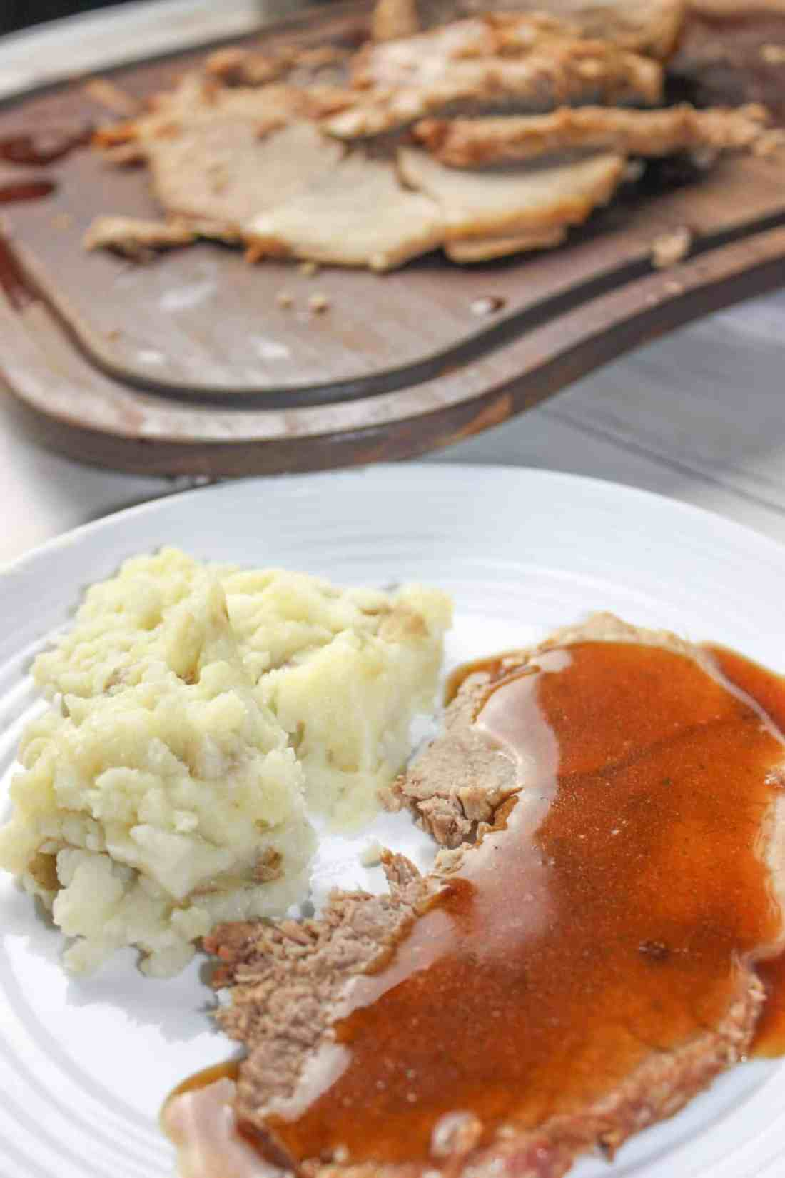 Instant Pot Beef Round Roast with Gravy takes a tougher cut of beef and turns it into a moist and tender main course.  This pressure cooker recipe makes it easy to serve up Sunday Dinner any day of the week!