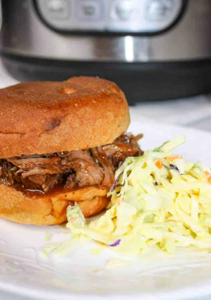 Instant Pot Pulled Pork is a delicious gluten free pulled pork recipe. The Instant Pot allows you to take a pork shoulder roast and turn it into a shredded masterpiece in less time than a slow cooker.