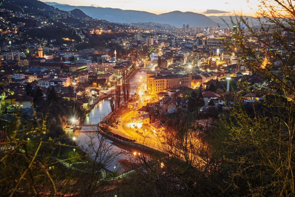 Vijećnica (City Hall) and Miljacka river floating through the night of Sarajevo