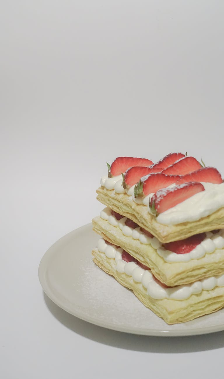 biscuits with cream and sliced strawberry toppings