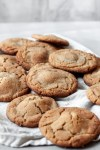 a pile of snickers stuffed peanut butter cookies