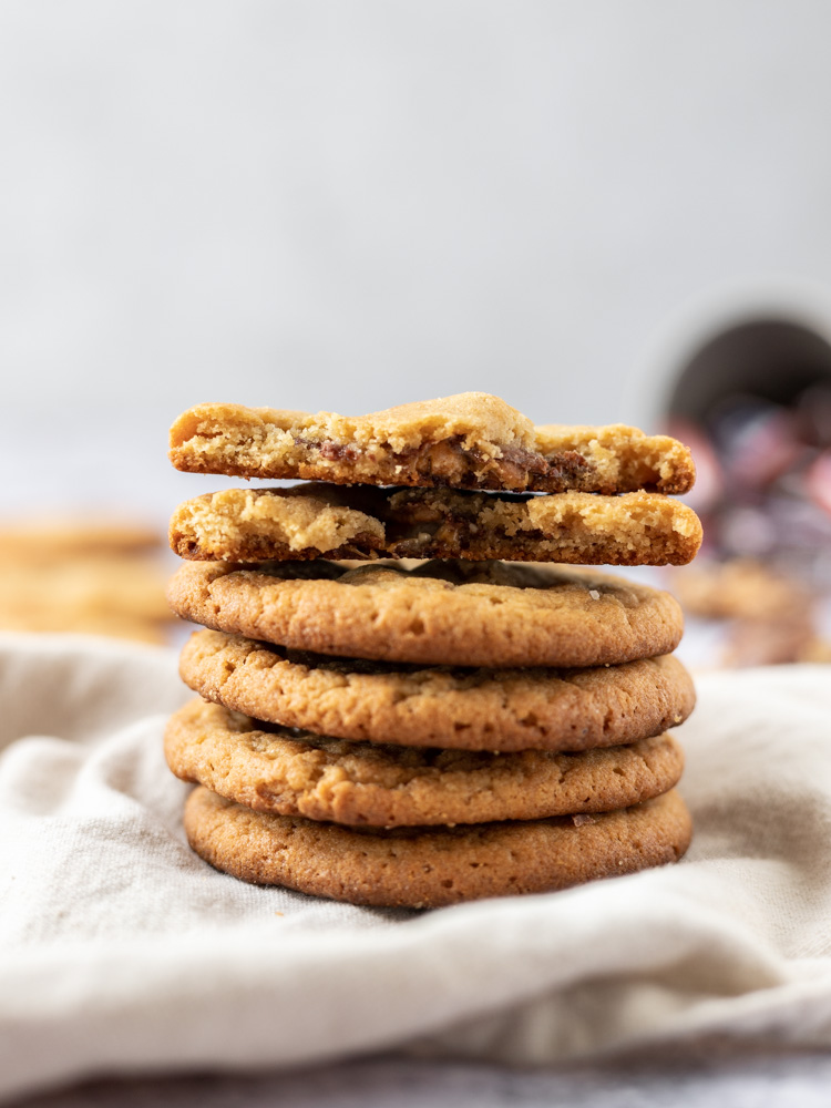 a stack of homemade peanut butter cookies stuffed with snickers