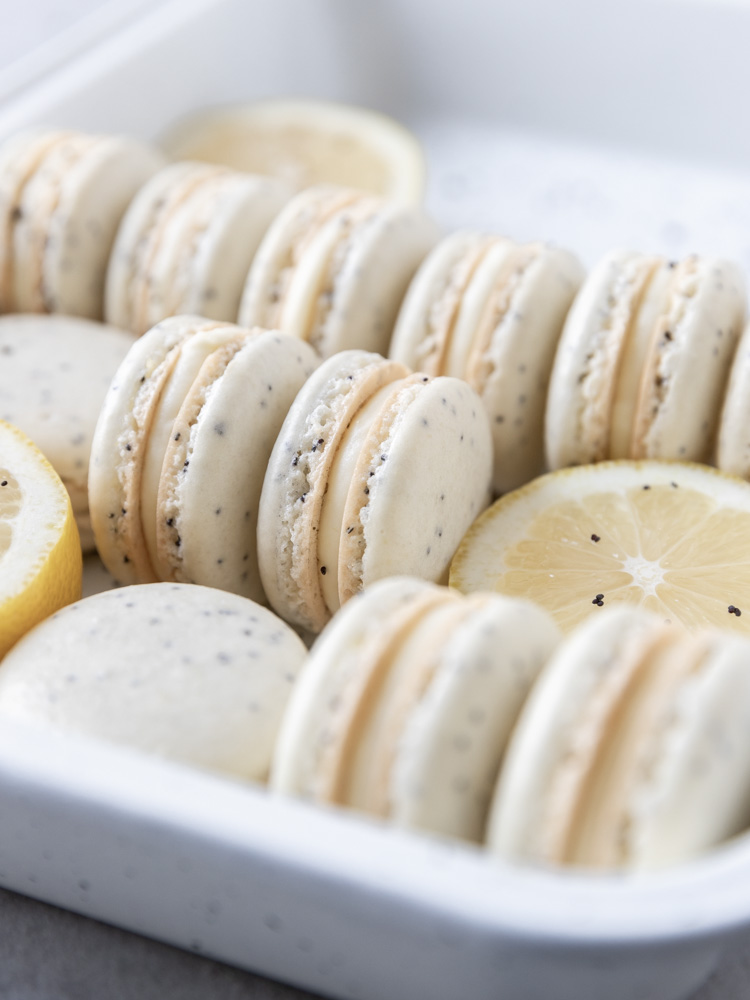 A side view of a tray of macarons
