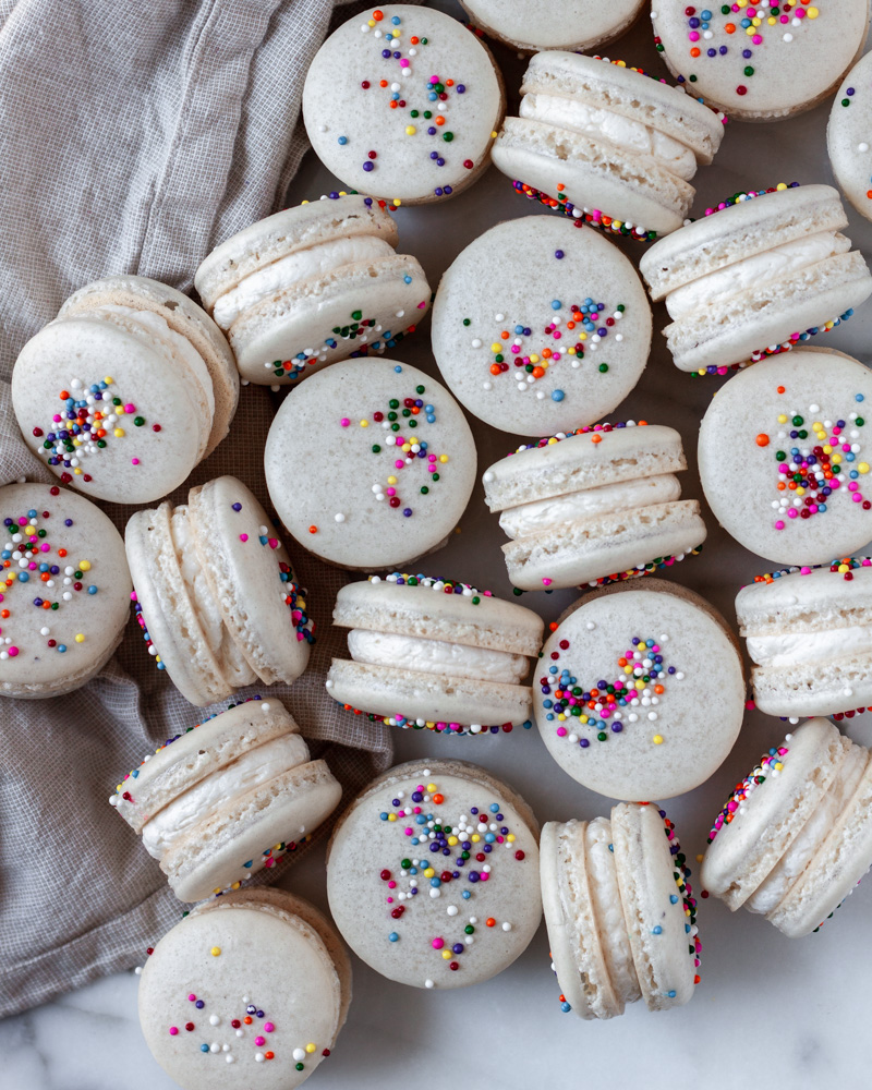 Looking down on a pile of birthday cake macarons