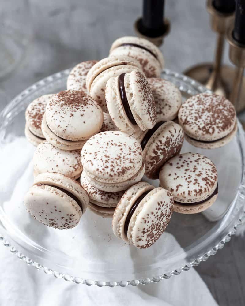 Chocolate ganache macarons on a cake stand