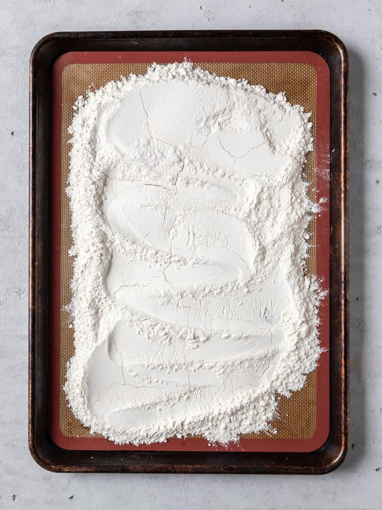 the heat-treated flour on a baking sheet