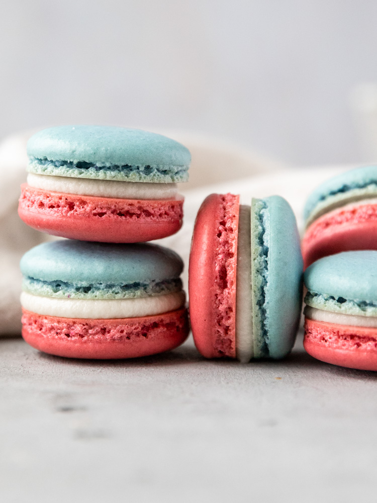A close up of a stack of red white and blue macarons