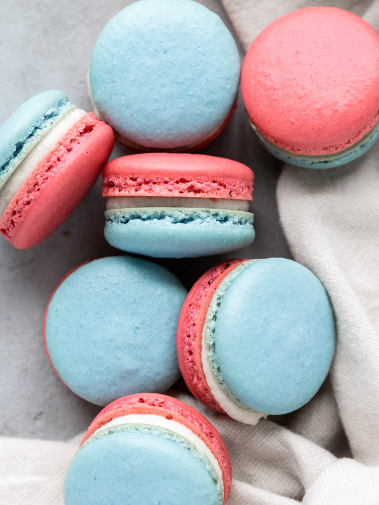 a pile of red white and blue macarons