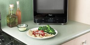 0 5 cu ft countertop microwave with add 30 seconds option