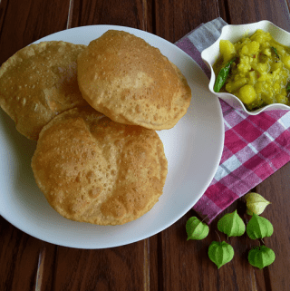 Puri / Poori - A simple, easy, healthy Indian, unleavened deep-fried wheat flatbread breakfast dish.