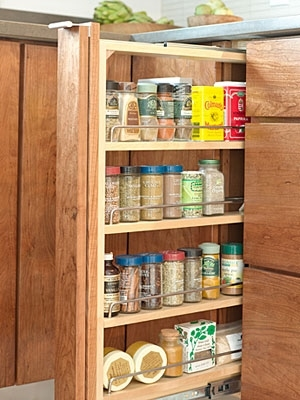Perfectly organized and hidden spice rack with custom kitchen cabinets in Northern Virginia home