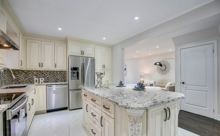 Ivory_white_classic_Kitchen_cabinet_lighting_flooring_countertops_completed