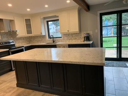 Large Island Kitchen Cabinets In Background