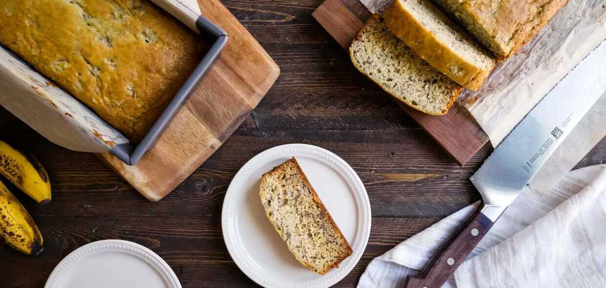 Buttermilk Banana Bread sliced on a cutting board