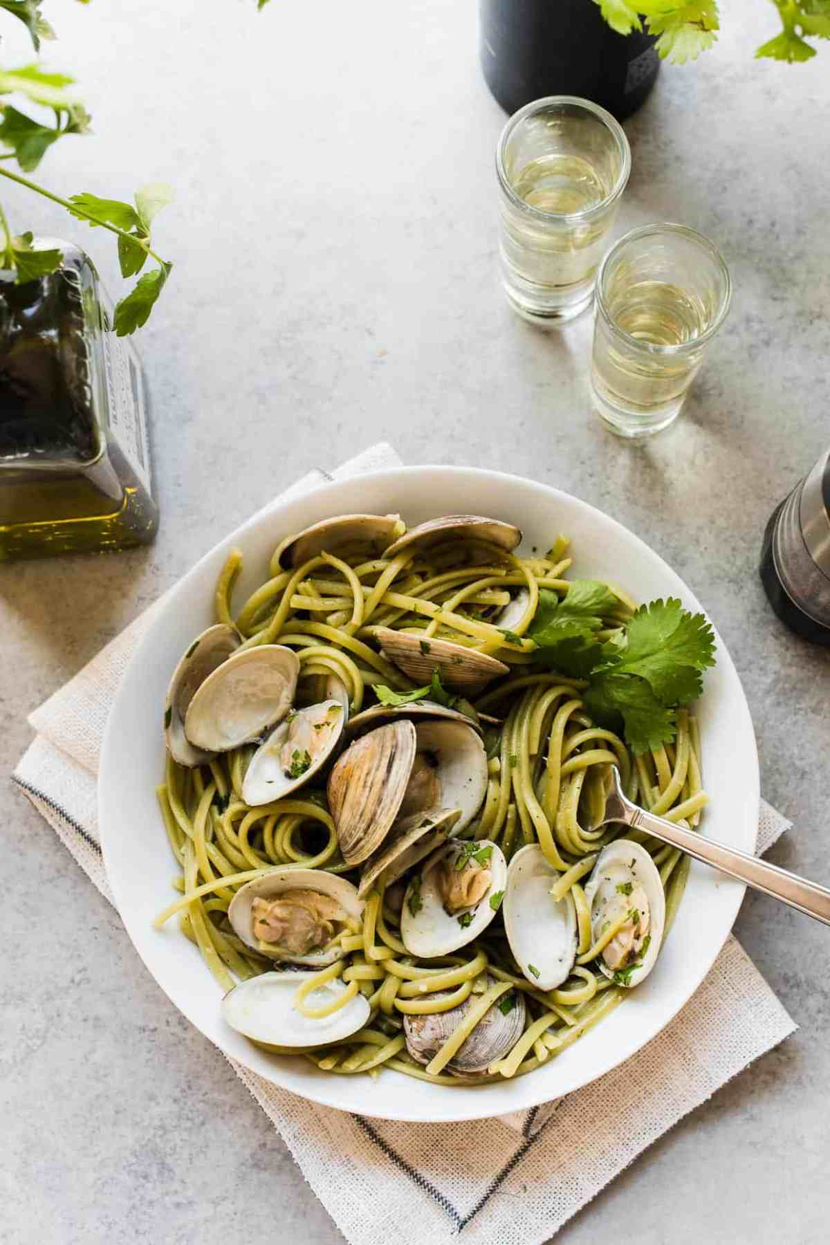 Linguine with Clams in Sake Red Chili Sauce in a white pasta dish with sake.