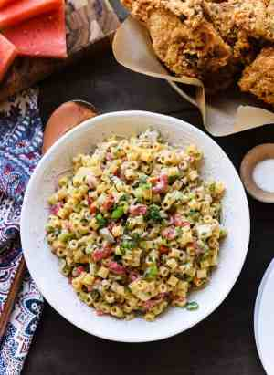 Fireworks Pasta Salad in a white bowl at a picnic