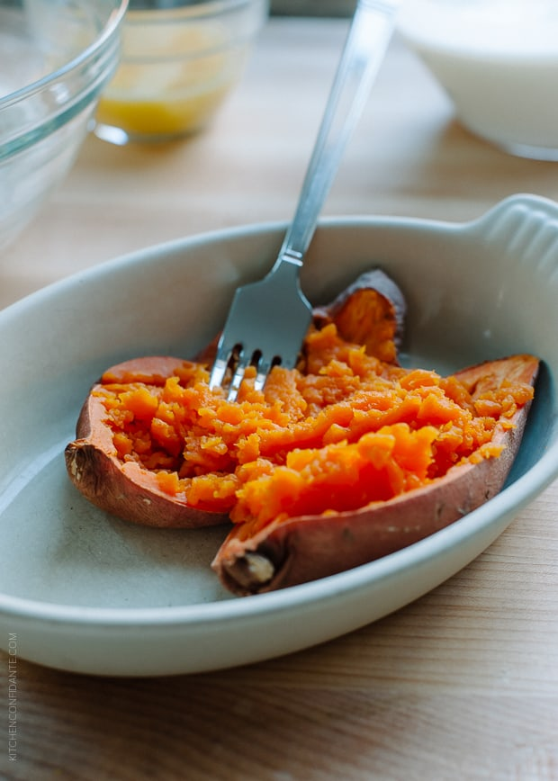 Sweet potato being prepared with a fork to use in a recipe for Sweet Potato Pancakes.
