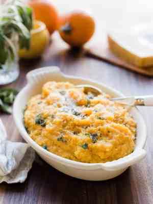 A white serving bowl filled with Pumpkin Sage Polenta.