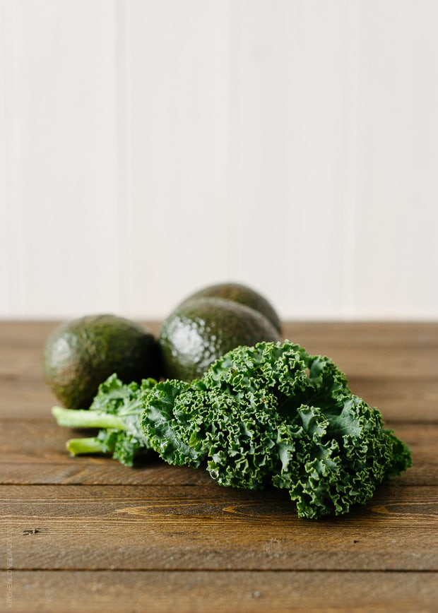 Avocado Kale Superfood Smoothie ingredients: avocados and kale leaves