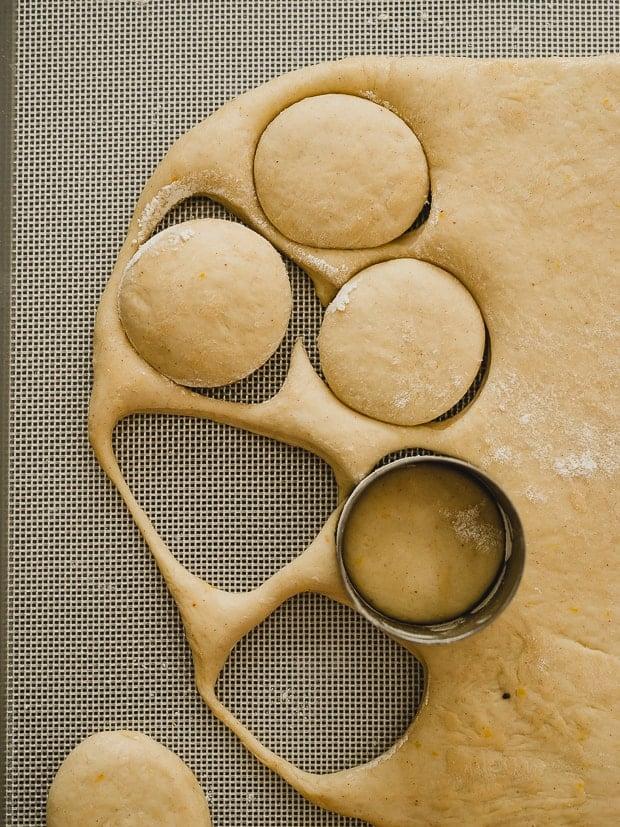Cutting out dough circles to make Nutella Filled Mini Doughnuts