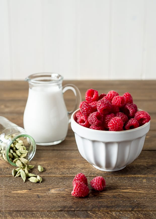 Raspberry, Coconut & Cardamom Panna Cotta | www.kitchenconfidante.com | Fresh raspberries add a touch of pink to this cardamom infused coconut panna cotta.