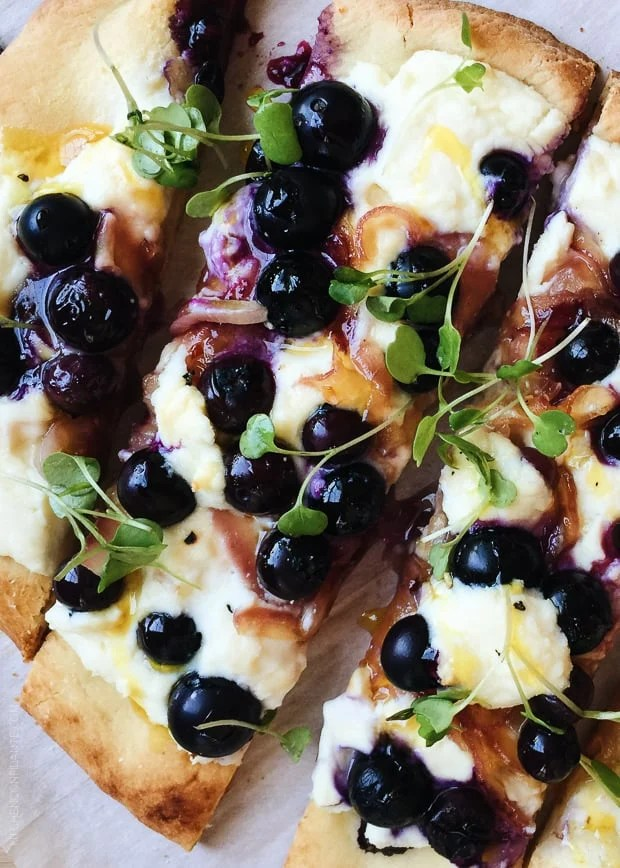 Close up shot of Blueberry, Feta and Honey-Caramelized Onion Naan Pizza.