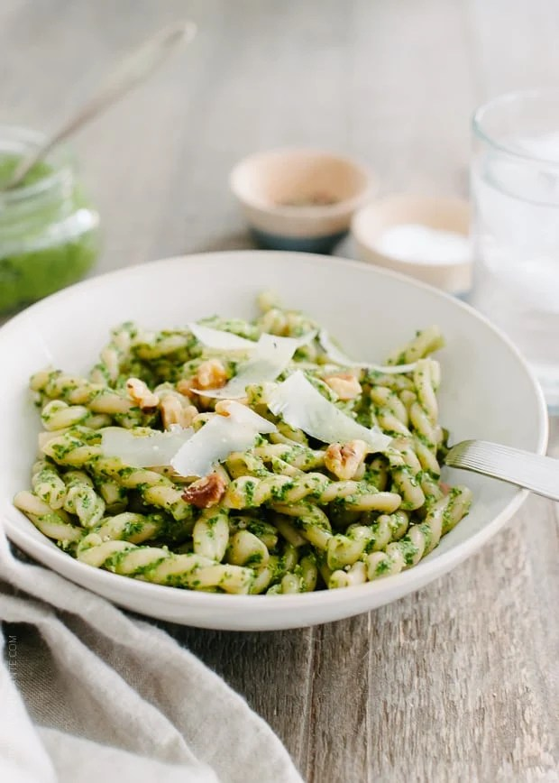 Swiss Chard Walnut Pesto Pasta   www.kitchenconfidante.com   A jar of pesto transforms into a simple lunch with pasta and leftover shredded chicken!