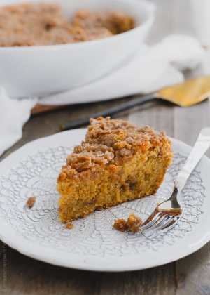 Slice of Buttered Rum and Candied Sweet Potato Crumb Cake from the Grandbaby Cakes cookbook on a white plate.