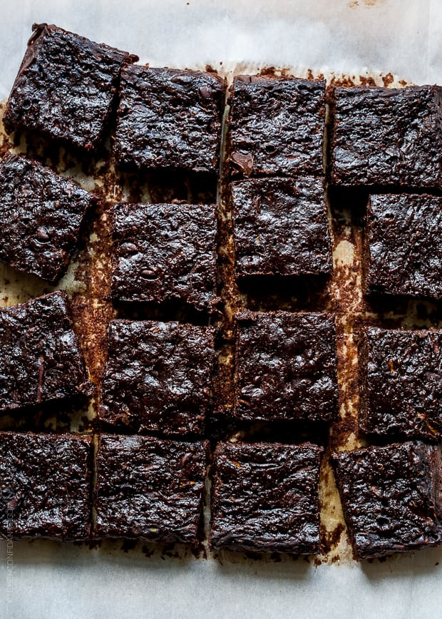 Slices of Zucchini Banana Brownies on parchment paper.