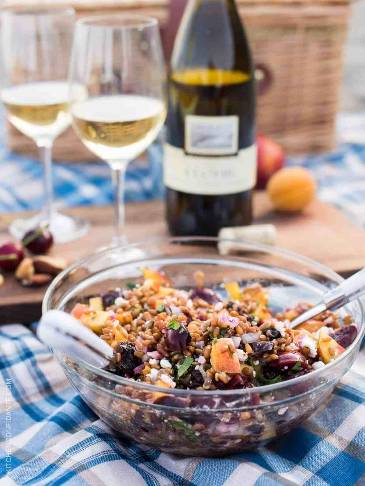 Summer Wheat Berry Salad with Stone Fruits and Goat Cheese has sweet cherries and nectarines and is picnic ready! Pair it with a glass of wine for your next summer adventure! #YouKnowJLohr #ad