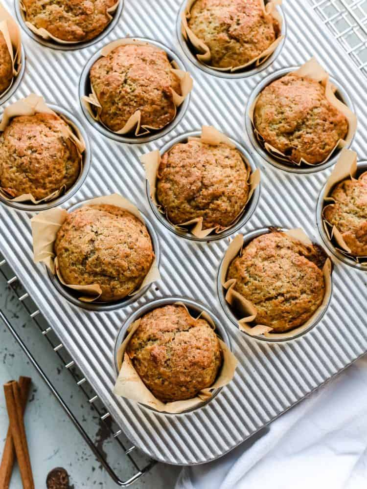 Applesauce Chia Muffins - a better way to start your day! Packed with protein from Greek yogurt and chia seeds, and deliciously apple spiced.