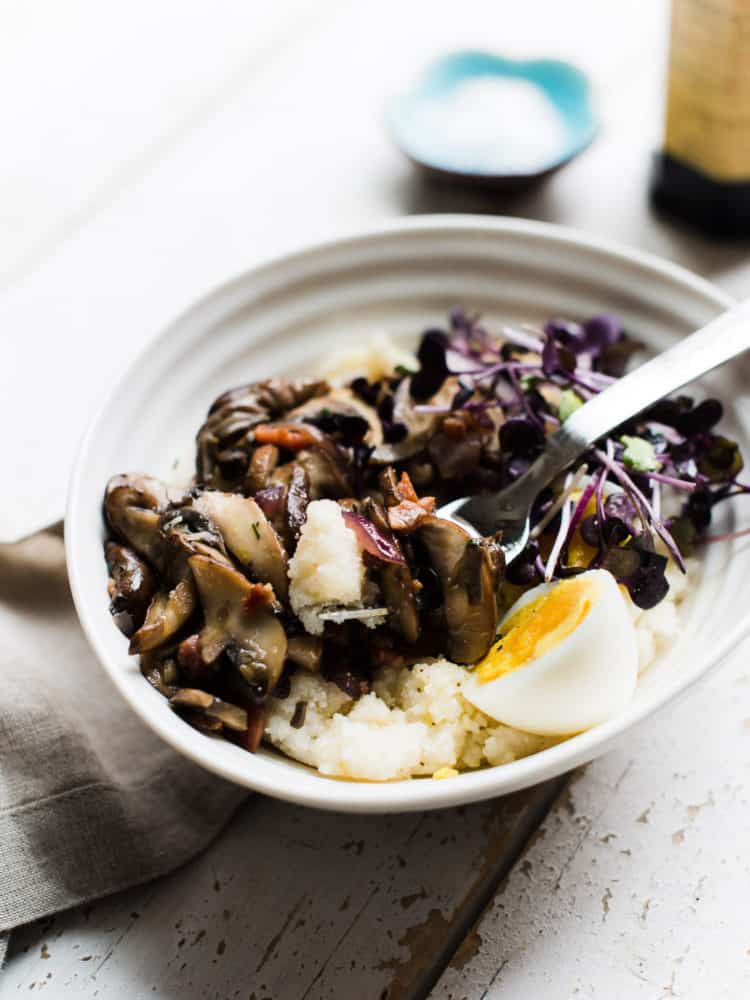 When you're craving something hearty in the morning, a simple, comforting Mushroom Polenta Breakfast Bowl bursting with mushrooms, onions, pancetta and an egg is all you need.