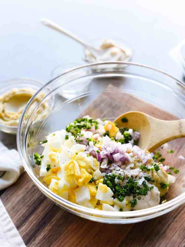 Ingredients for Hummus and Tahini Egg Salad in a bowl.