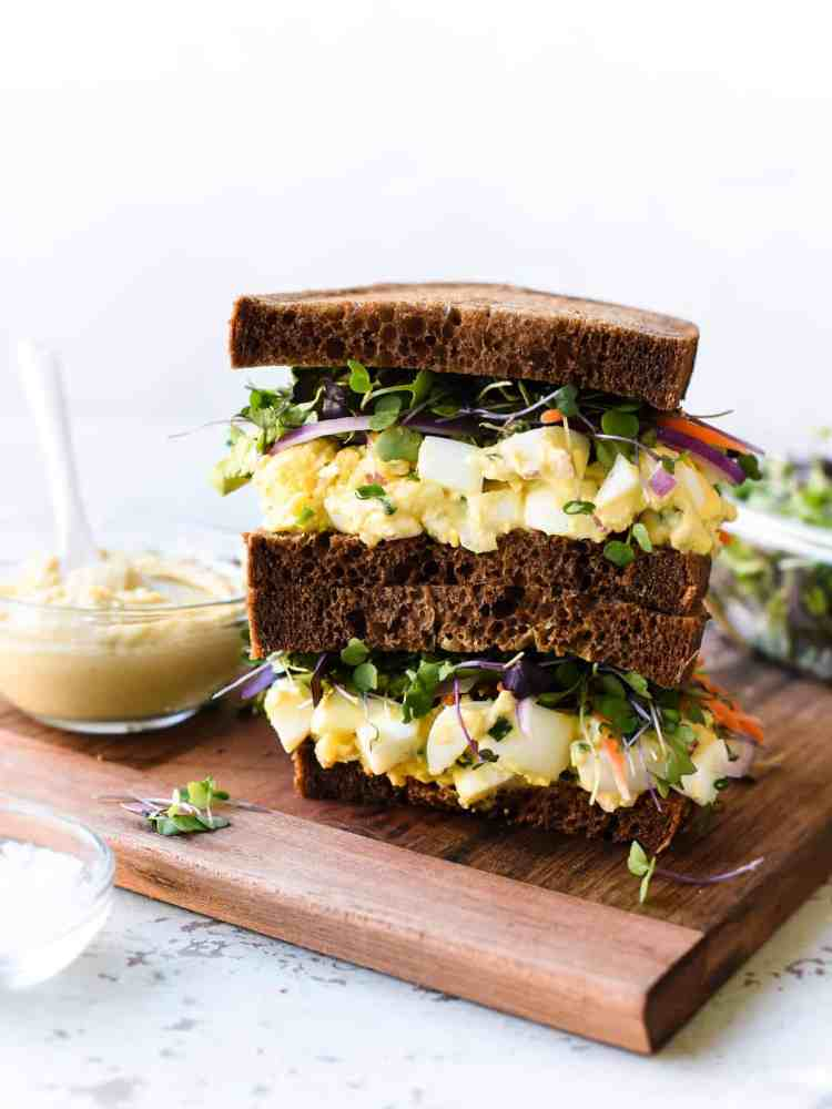 Stack of Hummus and Tahini Egg Salad sandwiches.