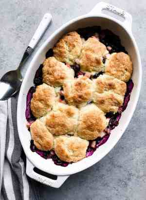 The combination of blueberry and rhubarb is nothing short of magical in the most humblest of desserts. This Blueberry Rhubarb Cobbler is the easiest recipe that you will turn to all rhubarb-season long!