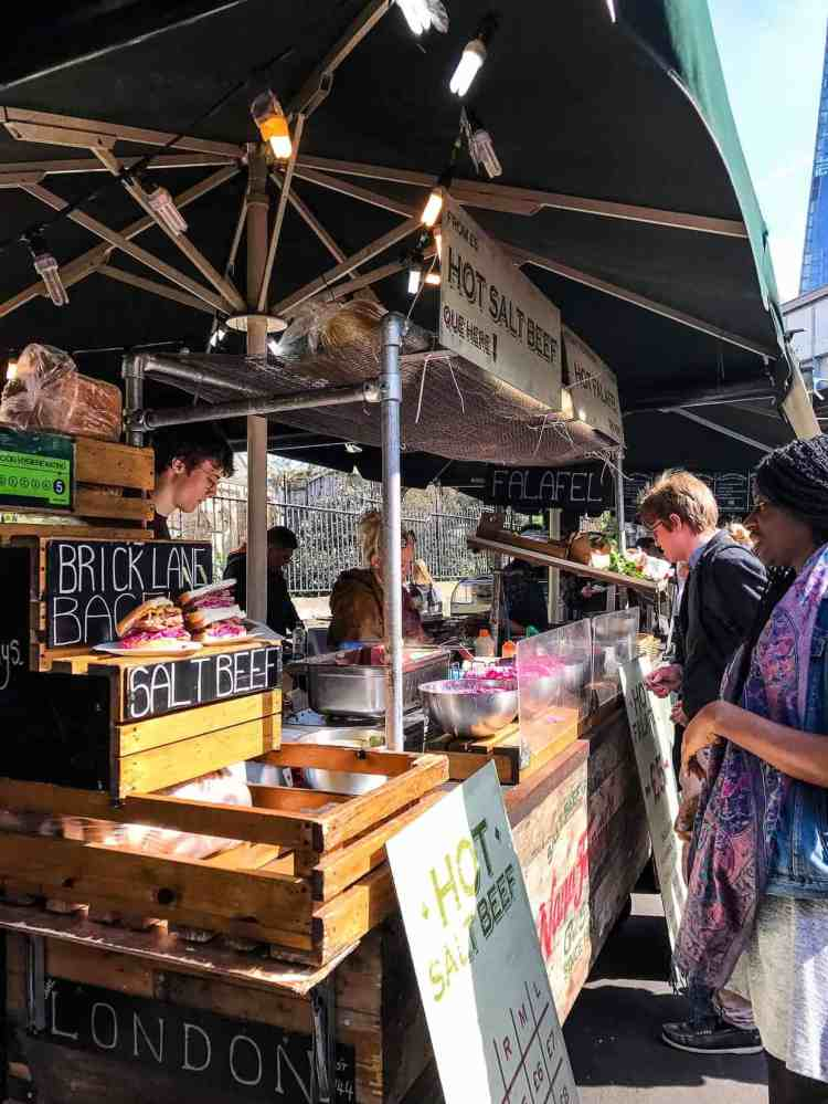 Hot food vendor market stall at Borough Market in London.
