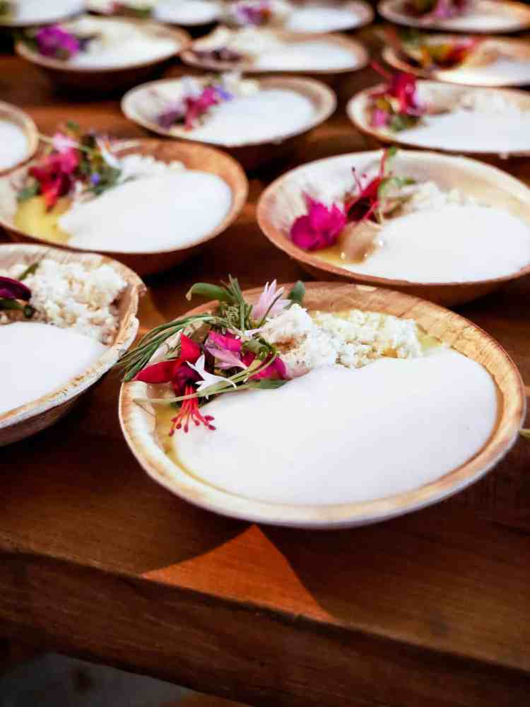 Small bowls of Thai Prawn Ceviche garnished with flowers at the Pebble Beach Food & Wine.